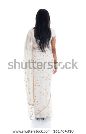 back view of indian woman in saree isolated on white background  - stock photo