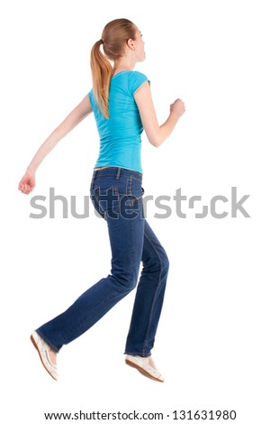 back view of jumping  woman  in  jeans. beautiful blonde girl in motion. girl running quickly. backside view of person.  Rear view people collection. Isolated over white background. - stock photo