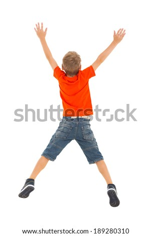 back view of little boy jumping on white background - stock photo