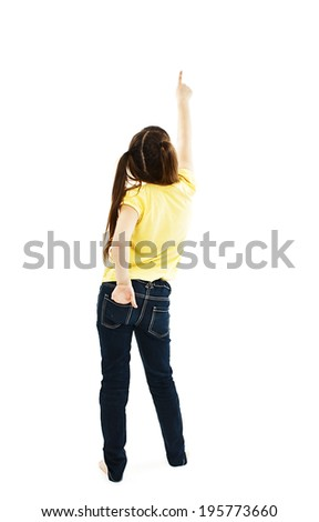 Back view of little girl points at wall. Rear view. Isolated on white background  - stock photo