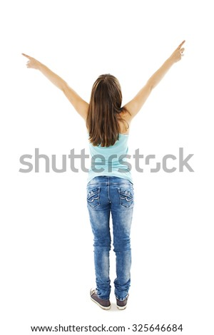 Back view of little girl points at wall with both hands. Rear view. Isolated on white background - stock photo
