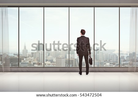 Back view of male with briefcase in modern interior with city view, looking into the distance. Research concept. 3D Rendering