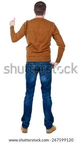 Back view of  man in blue pullove shows thumbs up. Rear view people collection.  backside view of person.  Isolated over white background. - stock photo