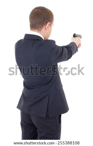 back view of man in business suit shooting with gun isolated on white background - stock photo