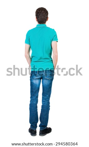 Back view of man in jeans. Standing young guy. Rear view people collection.  backside view of person.  Isolated over white background. The guy in a stylish aquamarine shirt is his hands in his pockets - stock photo