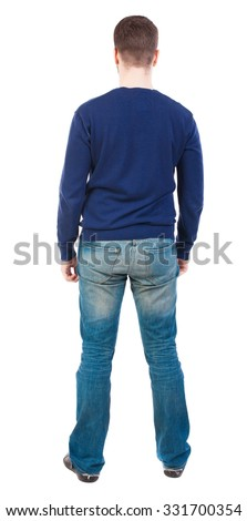 Back view of man in jeans. Standing young guy. Rear view people collection.  backside view of person.  Isolated over white background. Man in jeans and a blue sweater standing and looking. - stock photo