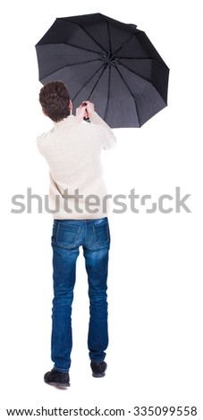 Back view of man in jeans under an umbrella. Standing young guy. Rear view people collection.  backside view of person.  Isolated over white background.  - stock photo