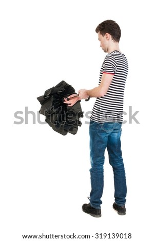 Back view of man in jeans  with umbrella. Standing young guy. Rear view people collection.  backside view of person.  Isolated over white background. The guy in the striped shirt open umbrella - stock photo
