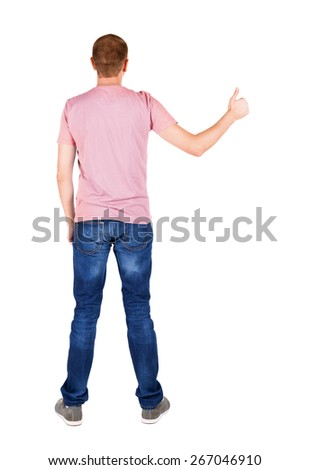 Back view of  man in t-shirt. shows thumbs up.   Rear view people collection.  backside view of person.  Isolated over white background. - stock photo