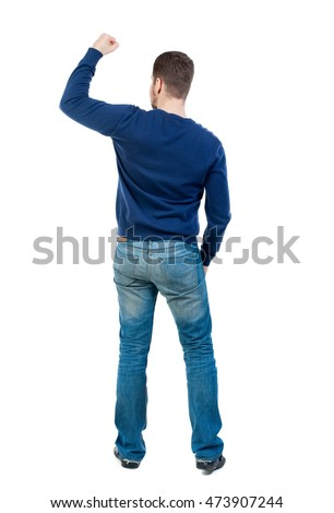 Back view of man. Isolated over white background. bearded man in blue pullover showing biceps.