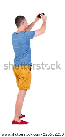 Back view of man photographing.  tourist in shorts. Rear view people collection.  backside view of person.  Isolated over white background. - stock photo