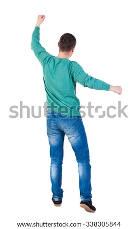 Back view of  man.  Raised his fist up in victory sign.   Rear view people collection.  backside view of person.  Isolated over white background. Joyful guy waving his fist. - stock photo