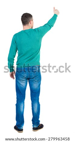 Back view of  man thumbs up. Rear view people collection. backside view of person. Isolated over white background.  The guy in the green jacket shows the big finger. - stock photo