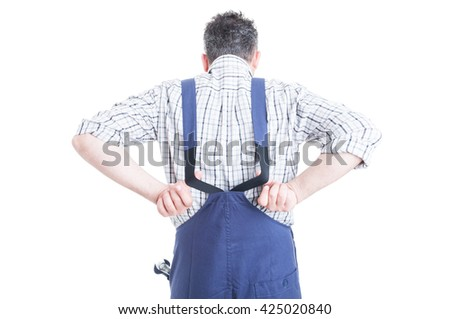 Back view of mechanic wearing blue overalls for work protection with steel wrench in his pocket isolated on white background - stock photo
