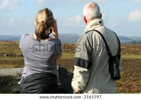 back view of people walking in a national park - stock photo