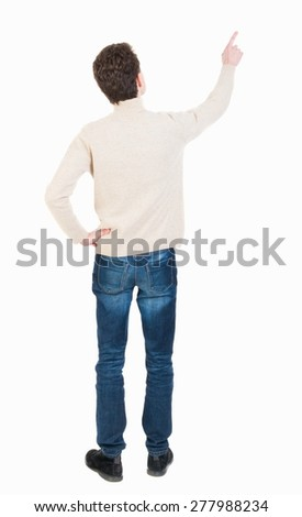 Back view of pointing business man. gesticulating young guy in black suit. Rear view people collection.  backside view of person.  A man shows and tells about something at the top. - stock photo