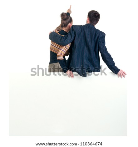 Back view of pointing business team with  empty billboard. young couple (man and woman). girl and guy in suit. Rear view people collection. backside view person. Isolated over white background - stock photo
