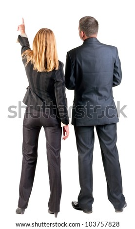 Back view of pointing business team. young couple (man and woman).  beautiful girl and guy in suit together. Rear view people collection.  backside view of person.  Isolated over white background.