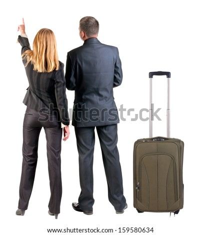 Back view of  pointing business team. young couple traveling with suitcas.   Rear view people collection.  backside view of person.  Isolated over white background. - stock photo