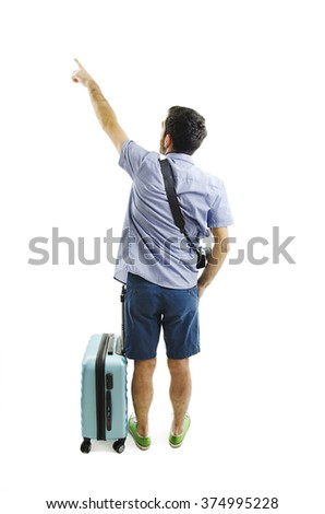 Back view of pointing man with suitcase. Backside view of person. Guy with a travel bag on wheels looking at something at the top. Isolated on white background - stock photo