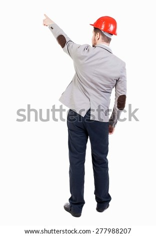 Back view of pointing young men in helmet. Young guy gesture. Rear view people collection. backside view person. Isolated over white background. bearded businessman at construction site refers to top