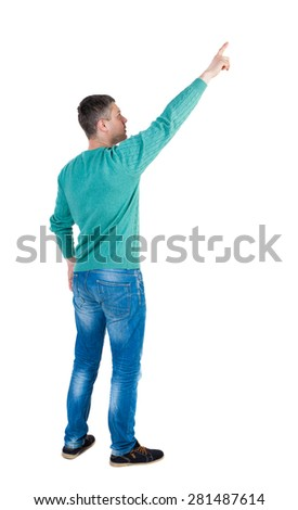 Back view of  pointing young men in jeans. Young guy  gesture. Rear view people collection.    Isolated over white background. The guy in the green jacket stands sideways and shows a finger at right - stock photo