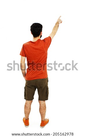 Back view of pointing young men in orange t shirt and shorts. Young guy gesture. Rear view people collection. backside view of person. Isolated over white background.  - stock photo