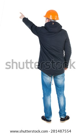 Back view of  pointing young men in parka and helmet. Young guy  gesture. Rear view people collection.  backside view of person.  Isolated over white background. Young engineer specifies left hand  - stock photo