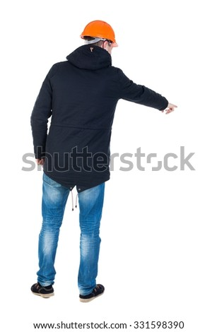 Back view of  pointing young men in parka and helmet. Young guy  gesture. Rear view people collection.  backside view of person.  Isolated over white background.   - stock photo