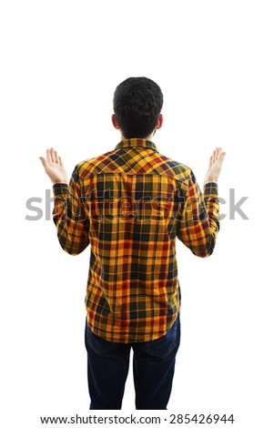Back view of pointing young men in plaid shirt and jeans. Young guy gesture. Rear view people collection. backside view of person. Isolated over white background.   - stock photo