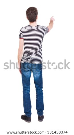 Back view of  pointing young men in  shirt and jeans. Young guy  gesture. Rear view people collection.  backside view of person.  Isolated over white background. Curly French shows a finger. - stock photo