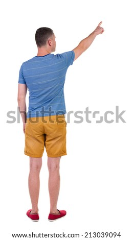 Back view of  pointing young men in  shorts. Young guy  gesture. Rear view people collection.  backside view of person.  Isolated over white background.  - stock photo