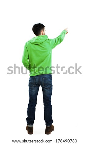Back view of pointing young men in sweatshirt and jeans. Young guy gesture. Rear view people collection. backside view of person. Isolated over white background.  - stock photo