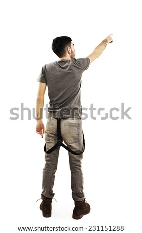 Back view of pointing young men in T- shirt and jeans. Young guy gesture. Rear view people collection. backside view of person. Isolated over white background. - stock photo
