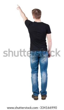 Back view of  pointing young men in  t-shirt and jeans. Young guy  gesture. Rear view people collection.  backside view of person.  Isolated over white background.   - stock photo