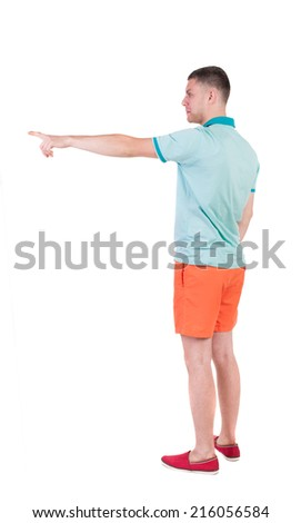 Back view of  pointing young men in  t-shirt and shorts. Young guy  gesture. Rear view people collection.  backside view of person.  Isolated over white background.  - stock photo