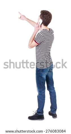 Back view of  pointing young men talking on cell phone. Young guy  gesture. Rear view people collection.    Isolated over white background. Curly guy on the phone tells what he saw.  - stock photo
