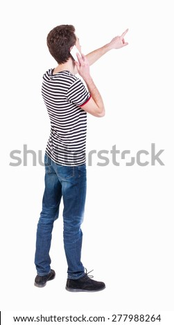 Back view of  pointing young men talking on cell phone. Young guy  gesture. Rear view people collection. backside view of person.  Isolated over white background. Curly guy on phone tells what he saw  - stock photo