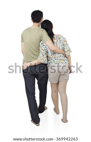 Back view of romantic young couple  hug and look into the distance, isolated on white background
