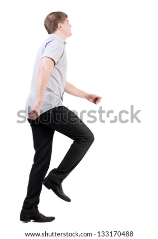 back view of running business man . walking businessman in motion. Rear view people collection.  backside view of person. Isolated over white background. quickly rushes young man isomewhere - stock photo