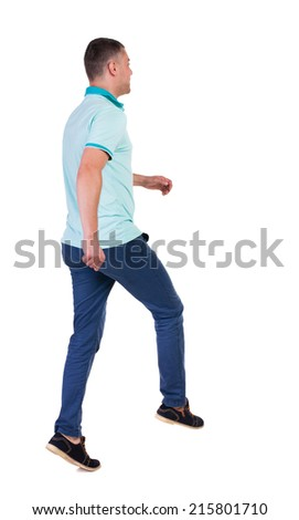 Back view of running man in blue polo. Walking guy in motion. Rear view people collection. Backside view of person. Isolated over white background. - stock photo