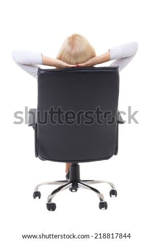 back view of satisfied business woman  with hands crossed behind her head sitting on office chair isolated on white background - stock photo