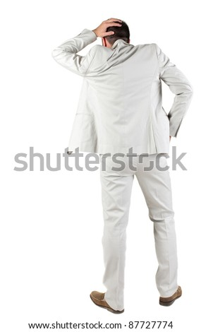 Back view of shocked and scared young business man. Holds hands upwards. Rear view. Isolated over white background. - stock photo