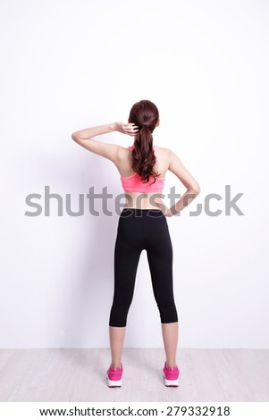 Back view of sport woman look and think with white wall background, great for your design or text, asian - stock photo