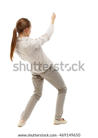 back view of standing girl pulling a rope from the top or cling to something. girl  watching. Rear view people collection.  backside view of person.  Isolated over white background. Skinny girl in