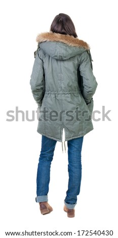 back view of standing young beautiful  brunette woman in park. girl in warm jacket  watching. Rear view people collection.  backside view of person.  Isolated over white background. - stock photo