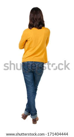 back view of standing young beautiful  brunette woman in yellow t-shirt. girl  watching. Rear view people collection.  backside view of person.  Isolated over white background. - stock photo