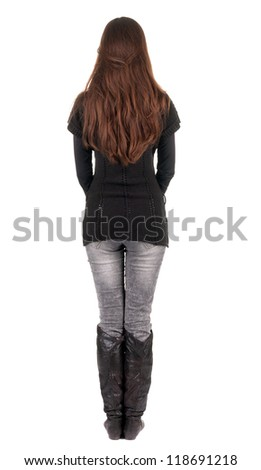 back view of standing young beautiful  woman.  brunette girl in jeans and sweater watching;. Rear view people collection.  backside view of person.  Isolated over white background. - stock photo