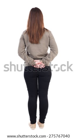 back view of standing young beautiful  woman. girl  watching. Rear view people collection.  backside view of person.  Isolated over white background. Girl standing with hands clasped behind his back.