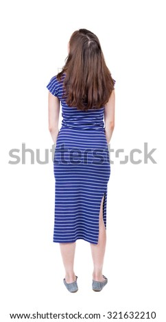 back view of standing young beautiful  woman.  girl  watching. Rear view people collection.  backside view of person.  Isolated over white background. A girl in a long blue dress looks up. - stock photo